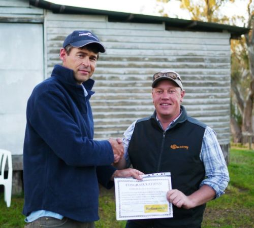 BIGG's Brett Nietschke presents the $500 voucher for Heritage Seeds to Pasture Challenge winner Chris Steinert.